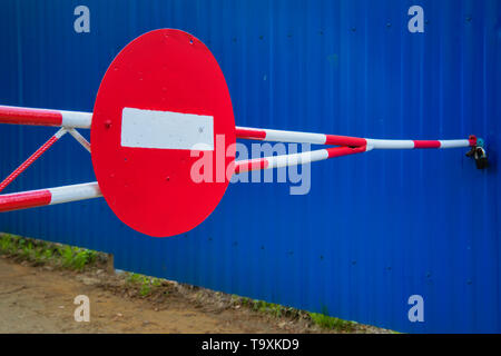 Close up Barrier Gate. Barrier with road signs. - Stock Photo