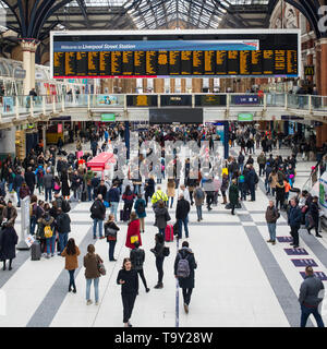 Liverpool Street Station, London, England, UK - April 2019: People tourists and commuters in the hall of the busy London Liverpool Street Station - Stock Photo