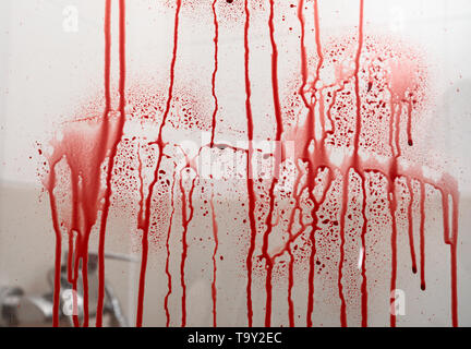 Blood streaks on glass door of shower cabin - Stock Photo