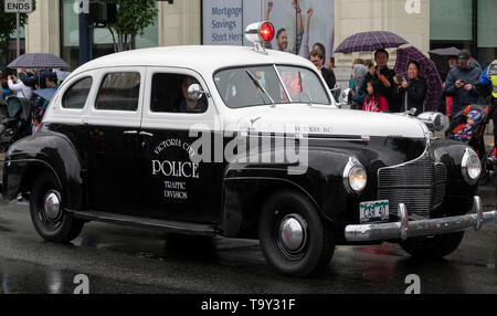 A vintage police car in the Victoria Day Parade on May 20, 2019 in Victoria, British Columbia, Canada. - Stock Photo