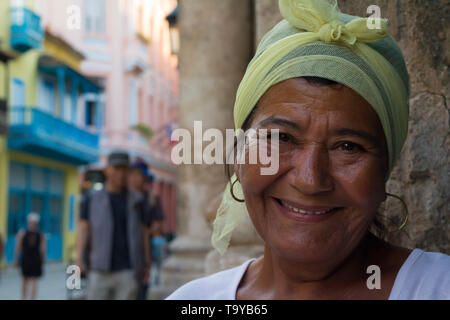 Middle aged Cuban woman who works as a fortune teller reading cards on the street in Havana. - Stock Photo