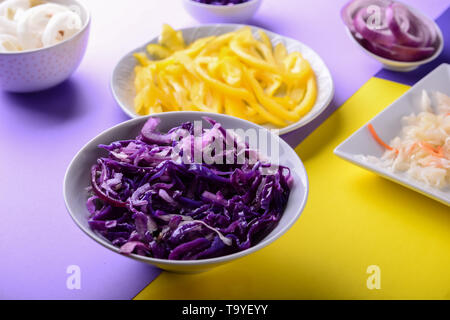 Assortment of tasty fermented vegetables on color background - Stock Photo