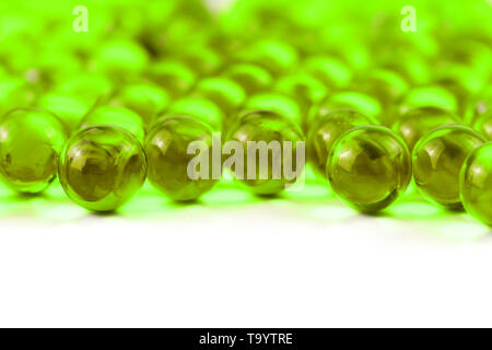 proton purple spherical ball capsules with selective focus isolated on white background. - Stock Photo