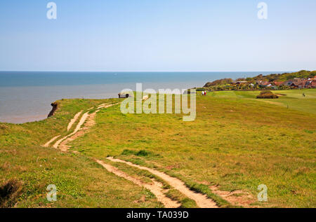 A view of the Paston Way footpath descending by the cliff top to the village of Overstrand, Norfolk, England, United Kingdom, Europe. - Stock Photo