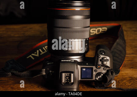 Moscow, Russia - January 8, 2019: New camera Canon EOS R 30.1 megapixel full-frame mirrorless interchangeable-lens on the table - Stock Photo