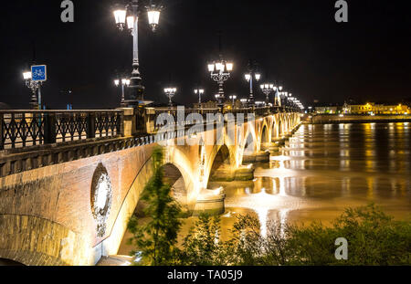Night view of The Pont de Pierre, bridge over the Garonne river in Bordeaux city, France - Stock Photo