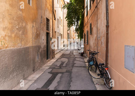 Side street in Pisa with scooter, Via Della Conce - Stock Photo