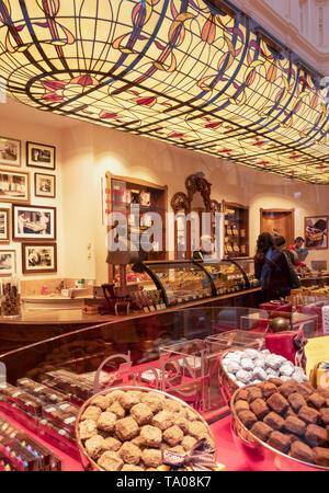 Belgium chocolate shop in the arcade Queen's Gallery Galerie de la Reine Galeries Royales Saint Hubert Royal Gallery of Saint Hubert Brussels,Belgium - Stock Photo