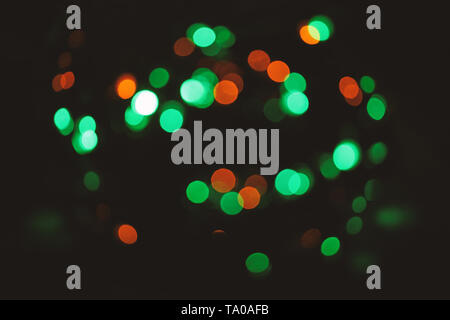 Festive backdrop with colorful lights. Bright and festive atmosphere of coming holiday. Christmas decorations concept. Defocused light of colorful garland. Abstract colorful bokeh background. - Stock Photo