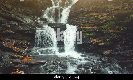 Pure Wild Highland Waterfall Creek Stony Ground. Rapid Transparent Mountain Creek Flow Rocky Ground Bottom. Mountainous Slope Multicolored Foliage Clean Ecology Concept