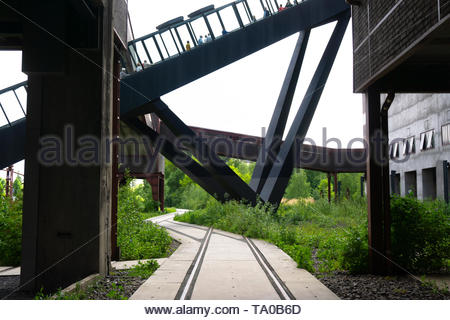 Modern footpath and a escalator in an former industrial area with tourism - Stock Photo