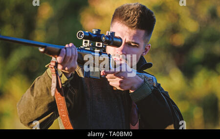 Hunting brutal masculine hobby. Hunting and trapping seasons. Bearded serious hunter spend leisure hunting. Look there. Noticed game. Man brutal unshaved gamekeeper nature background. Hunting permit. - Stock Photo