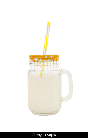 Mason jar with striped plastic tube with milk isolated on white background. Concept of World Milk Day, proper healthy nutrition. Side view. - Stock Photo