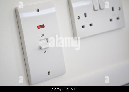 A power on off switch in the on position and socket. - Stock Photo