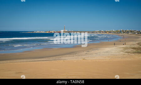 Panoramic view of the National Park of Cabo Polonio and its beach with the lighthouse and houses in the background, Uruguay - Stock Photo