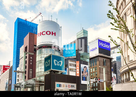 7 April 2019: Tokyo, Japan - Metro logo in front of massed skyscrapers in the Ginza district, downtown Tokyo. - Stock Photo