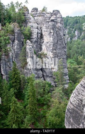 Mountain landscape of Saxon Switzerland. Forest-covered rocks. - Stock Photo