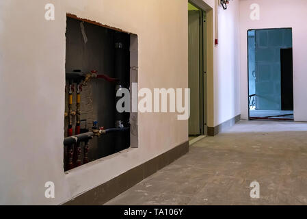 Corridor in newly built modern appartment building with facilities - Stock Photo