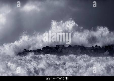Big stormy wave splash. Northern portuguese coast. Black and white toned blue. - Stock Photo