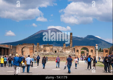 Tourists in the forum of Pompeii  the Roman city near Naples in the Campania region of Italy, Destroyed by volcanic eruption of Mount Vesuvius. - Stock Photo