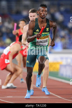 YOKOHAMA, JAPAN - MAY 11: Ashley Hlungwani receives the baton from Pieter Conradie in the mens 4x400m relay during day 1 of the IAAF World Relays at Nissan Stadium on May 11, 2019 in Yokohama, Japan. (Photo by Roger Sedres/Gallo Images) - Stock Photo