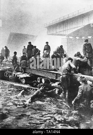 In late January, the Red Army reached the Oder and they built a bridgehead on the western bank of the river north of Kostrzyn nad Odra. Russian pioneers stand up to the waist in the ice cold water of the Oder during the bridge construction. - Stock Photo