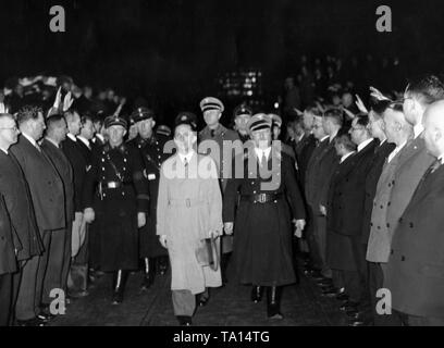 Joseph Goebbels (left) and Robert Ley (right) meet in the hall of the AEG in Brunnenstrasse, Berlin, for a work demonstration on the occasion of the one-year existence of the Nazi organization 'Kraft durch Freude' ('Strength through Joy'). - Stock Photo