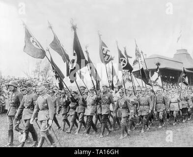 Members of front fighter organizations and of Freikorps associations parade with swastika flags and the former Reichskriegsflagge (Imperial War Flag) on May 11 on the Deutscher Tag (German Day) in Halle. - Stock Photo