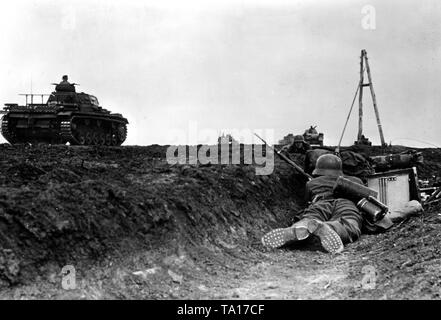 Station in a road ditch during battles in the southern section of the Eastern front. On the road is a Panzer III. War correspondent: - Stock Photo