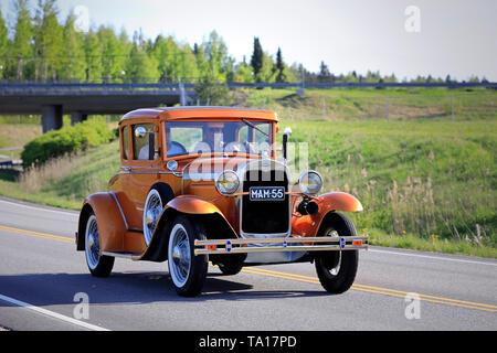Salo, Finland. May 18, 2019. Beautiful orange Ford Model A classic car on the road on Salon Maisema Cruising 2019. - Stock Photo