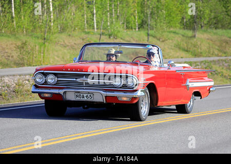 Salo, Finland. May 18, 2019. Classic 1960s red Chevrolet Impala Convertible on the road on Salon Maisema Cruising 2019. - Stock Photo