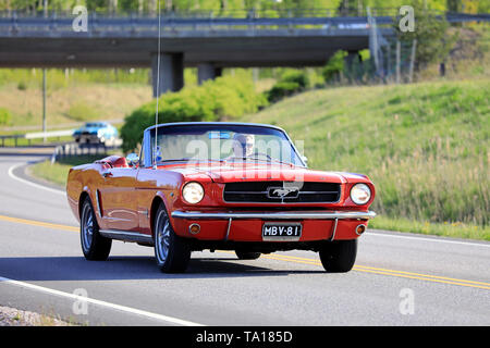 Salo, Finland. May 18, 2019. Classic 1960s red Ford Mustang convertible on the road on Salon Maisema Cruising 2019. - Stock Photo