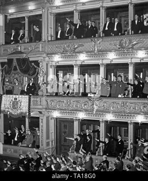 Presidential lodge of the National Theater in Prague. Joseph Goebbels is watching a performance together with Czech President Emil Hacha. Before the performance, the audience gives the Hitler salute. The first Slovak Republic was founded on Hitler's command in March 1939, and Bohemia and Moravia were occupied by the Wehrmacht. - Stock Photo