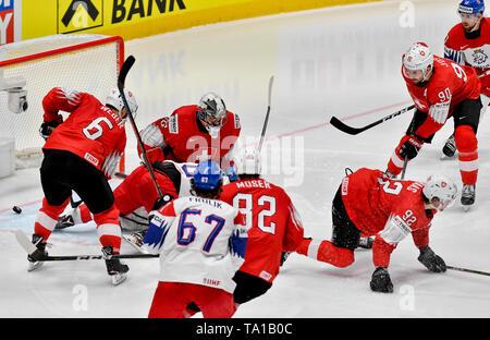 L-R Yannick Weber (SUI), Dominik Simon (CZE), Reto Berra (SUI), Michael Frolik (CZE), Simon Moser, Gaetan Hass, Roman Josi (all SUI) and Filip Hronek (CZE) in action during the match between Czech Republic and Switzerland within the 2019 IIHF World Championship in Bratislava, Slovakia, on May 21, 2019. Simon scores goal. (CTK Photo/Vit Simanek) - Stock Photo