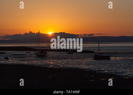 Morecambe Lancashire, United Kingdom. 21st May, 2019. Another fine spring day draws to a close with a glorious sunset over Morecambe Bay. As the sun goes down a breeze begins to blow along the prom cooling the evening temperatures. Credit: Photographing North/Alamy Live News - Stock Photo