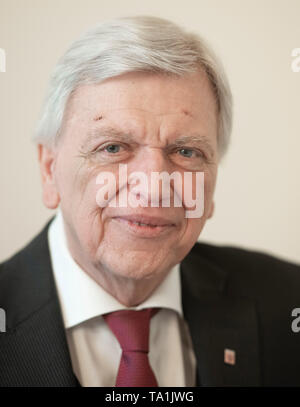 21 May 2019, Germany (German), Wiesbaden: The Hessian Prime Minister Volker Bouffier (CDU) in conversation with the dpa in a room of the State Chancellery. Bouffier stressed the importance of the Basic Law of the Federal Republic of Germany for everyday social and political life. Photo: Boris Roessler/dpa - Stock Photo