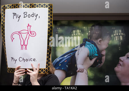 An activist seen holding a placard that says my body my choice during the protest. Abortion rights activists took part in stop the bans rally nationwide after multiple states pass fetal heartbeat bills. - Stock Photo