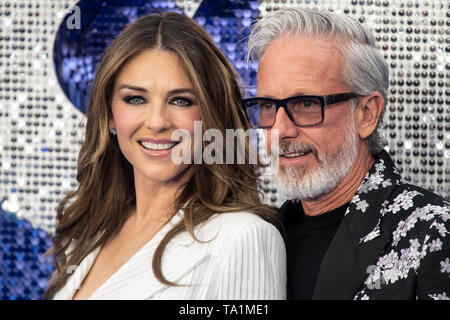 Patrick Cox and Elizabeth Hurley attends the 'Rocketman' UK premiere at Odeon Leicester Square on May 20, 2019 in London, England. - Stock Photo