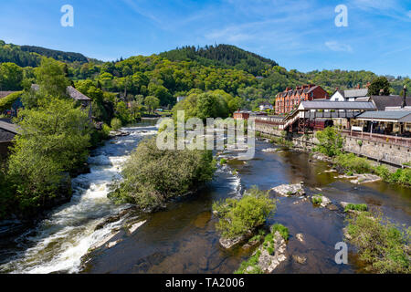 Llangollen Denbighshire Wales May 14, 2019 Small falls on the river Dee as it flows through the town of Llangollen - Stock Photo