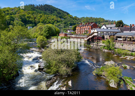 Llangollen Dengighshire Wales May 14, 2019 Small falls on the river Dee as it flows through the town of Llangollen - Stock Photo