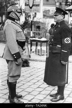 After the annexation of Austria to the German Reich the Austrian police gets new uniforms. On the right is the old uniform of the Viennese police and on the left the new uniform. - Stock Photo