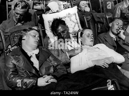 Vacationers are sunbathing on board a cruise ship of the Nazi organization 'Kraft durch Freude' ('Strength through Joy') on its way to Norway. - Stock Photo