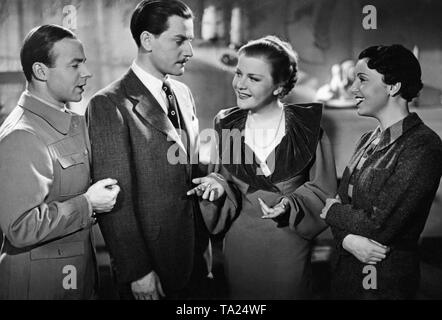 Heinz Ruehmann as David (left), Adolf Wohlbrueck as Philipp, Jenny Jugo as Gaby (middle) and Renate Mueller as Viola (right) in the German feature film 'Hokum', directed by Willi Forst. - Stock Photo