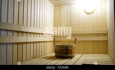 Sauna accessories are in the interior of the steam room. The interior of the sauna. Sauna from linden. - Stock Photo