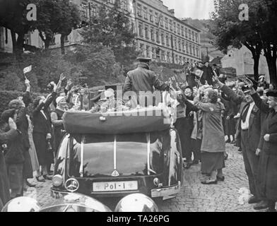 Reich Minister of the Interior Wilhelm Frick visits Joachimsthal (today Jachymov) on October 18, 1938. He greets people standing in a moving car. - Stock Photo