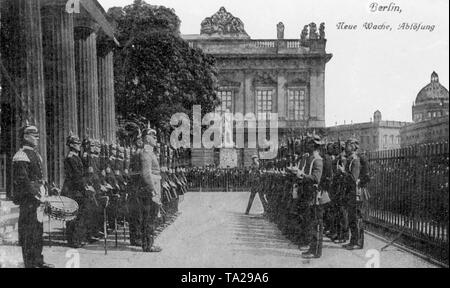 Changing of the guard at the Neue Wache in Berlin. It was built between 1816-18 according to plans by Karl Friedrich Schinkel as a memorial to the fallen soldiers of the Napoleonic Wars. - Stock Photo
