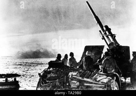 The photo shows an 8.8 cm Flak 41, a heavy anti-aircraft gun in the fight against Russian combat airplanes that attack refugee convoys and supply columns. - Stock Photo