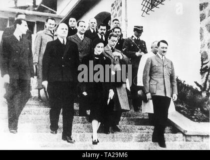 Visit of the abdicated British King Edward VIII (Duke of Windsor) and his wife Wally Simson (Duchess of Windsor) at the Berghof on the Obersalzberg near Berchdesgaden. In the photo Adolf Hitler accompanied his guests to the car after their visit. - Stock Photo
