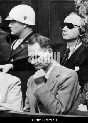 Rudolf Hess clenches his fist during the trial of the major war criminals in Nuremberg Palace of Justice, 1945 - Stock Photo