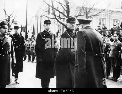 Ernst Neumann (center, looking to the camera), the Memel Nazi leader, is greeted upon arrival to the celebration marking the reconstruction of the Memel memorial to Emperor Wilhelm I, following the annexation of the Memel area by the German Reich. - Stock Photo